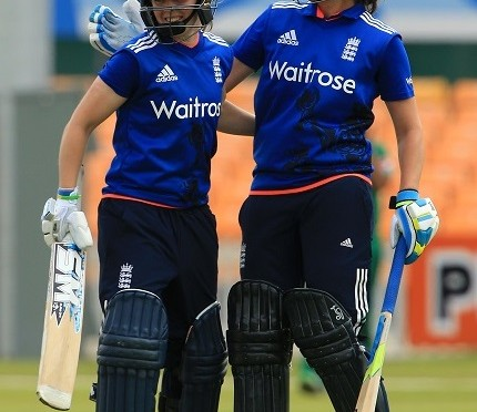 LEICESTER, ENGLAND - JUNE 21:  Heather Knight celebrates reaching 50 runs with Natalie Sciver of England during the 1st Royal London ODI match between England Women and Pakistan Women at Grace Road Cricket Ground on June 21, 2016 in Leicester, England. (Photo by Stephen Pond/Getty Images)